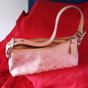 Small pink coach bag.